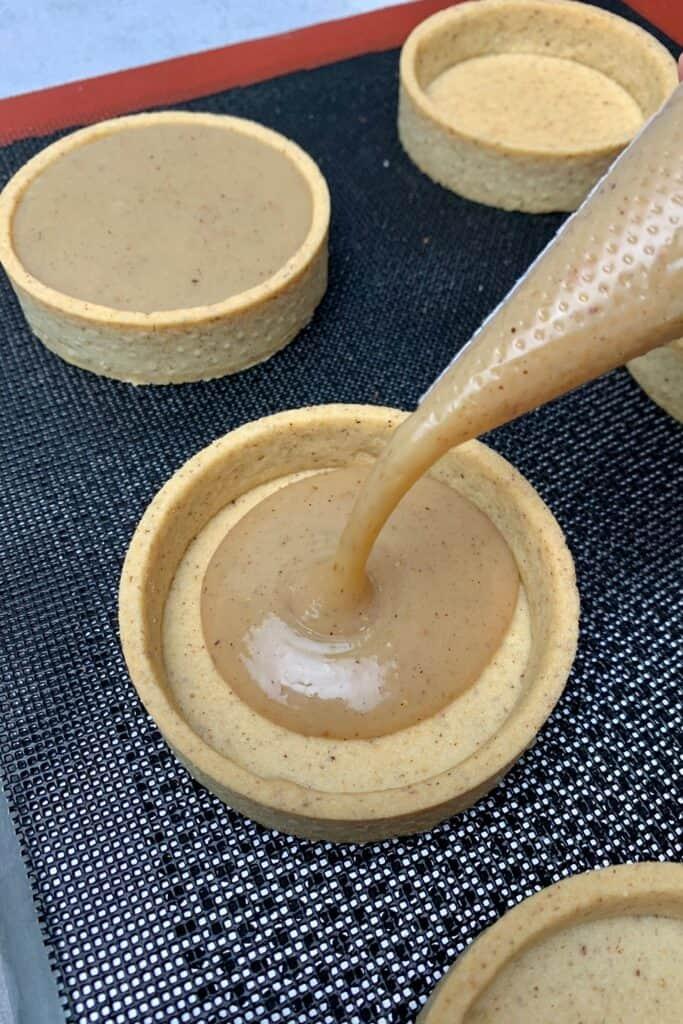Triple Hazelnut Tart with Gold Chocolate disk decoration
